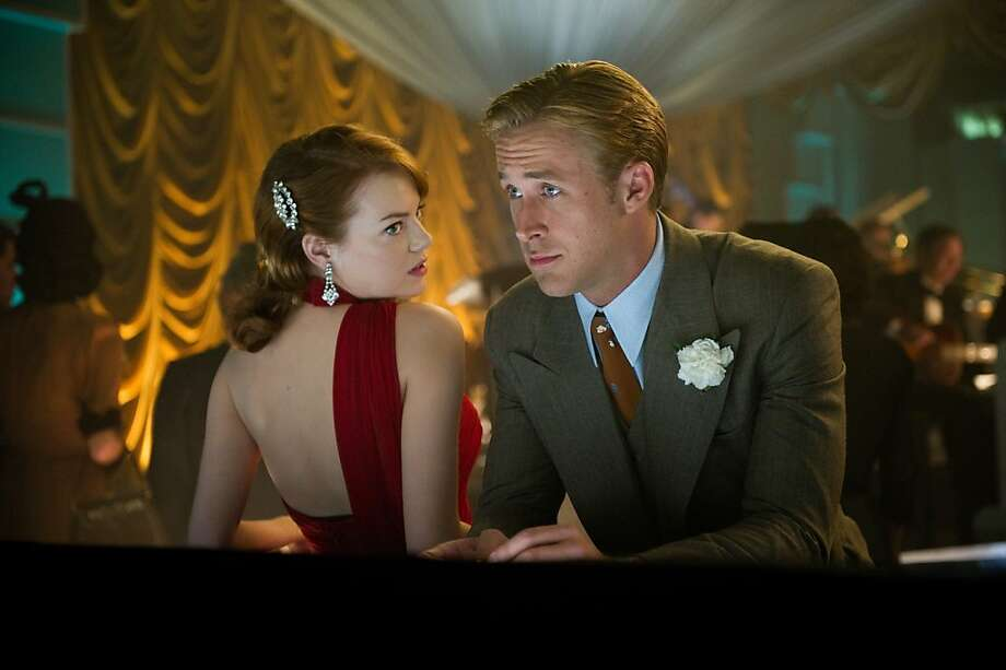 Emma Stone, out of place as a film noir heroine, and Ryan Gosling as Brolin's assistant. Photo: Wilson Webb, Warner Bros. Pictures