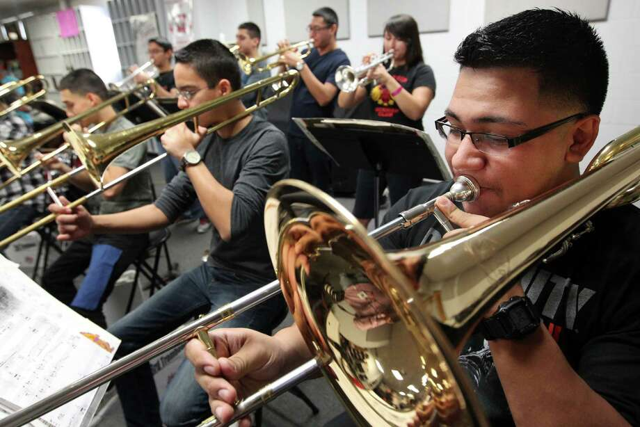Trombone player Eduardo Gutierrez, 18, foreground, practices with the Waltrip High School Ram Band's jazz ensemble, which is raising money for a trip to Washington, D.C., for the inauguration. With seven days until their deadline, the band still needs $40,000. Photo: Mayra Beltran, Staff / © 2012 Houston Chronicle