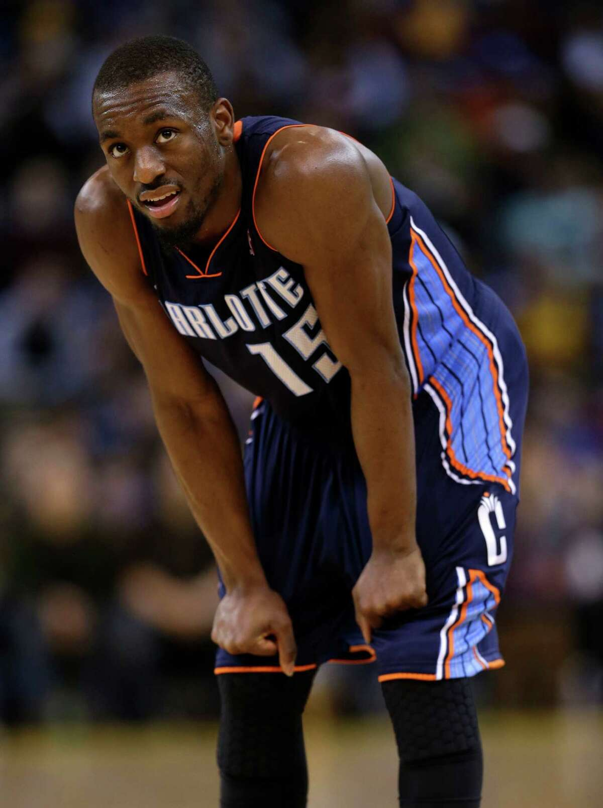 Charlotte Bobcats point guard Kemba Walker (15) in action against the Golden State Warriors in an NBA basketball game in Oakland, Calif., Friday, Dec. 21, 2012. (AP Photo/Marcio Jose Sanchez)
