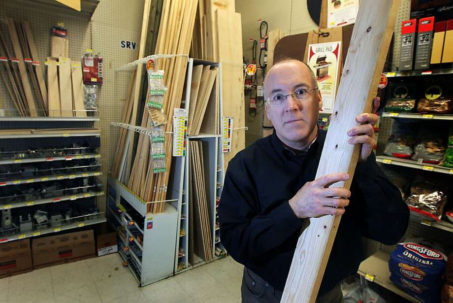 Gene Pedrotti owner-manager of Ace Hardwar holds a piece of framing lumber that the State of California has a separate tax code for wood products Tuesday Jan 8, 1013 in Benicia California. Photo: Lance Iversen, The Chronicle
