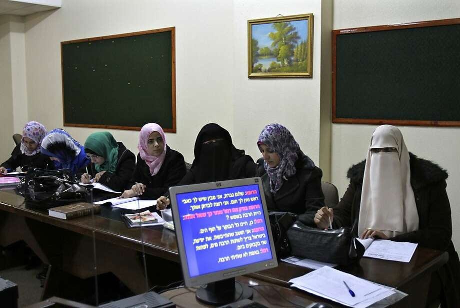 Palestinian students study Hebrew at a stronghold of Hamas, the Islamic University in Gaza City. Photo: Adel Hana, Associated Press