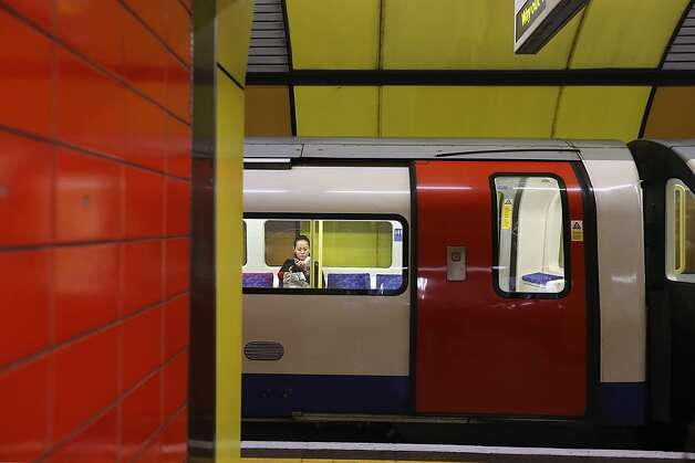 LONDON, ENGLAND - JANUARY 09:  A passenger sits on a train at Baker Street Underground Station on January 9, 2013 in London, England. The London Underground commonly called the Tube, is the oldest of its kind in the world, and marks it's 150th anniversary on January 10, 2013. The network carries approximately a quarter of a million people around its network of 249 miles of track every day. The Baker Street station has more platforms than any other on the network with 10, and is one of the oldest of the 270 stations on the entire network.  (Photo by Dan Kitwood/Getty Images) Photo: Dan Kitwood, Getty Images