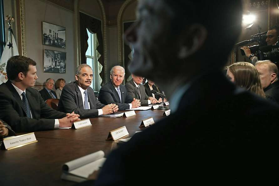 Attorney General Eric Holder (second from left) sits next to Vice President Joe Biden at the beginni