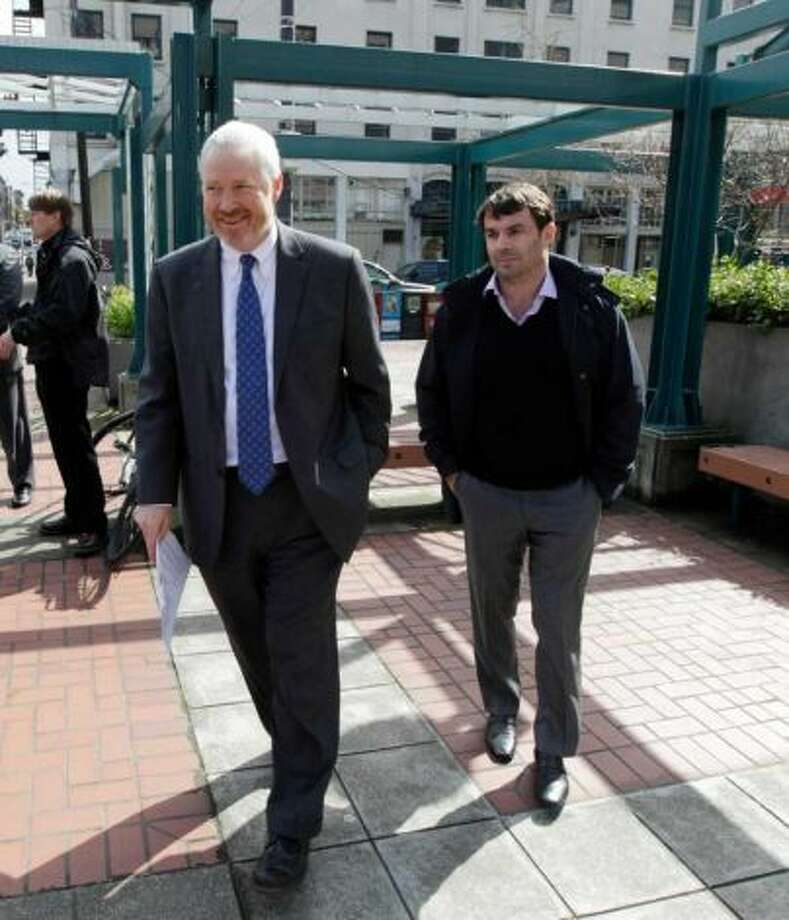 Seattle Mayor Mike McGinn and arena proponent Chris Hansen, pictured in 2011. (Associated Press)