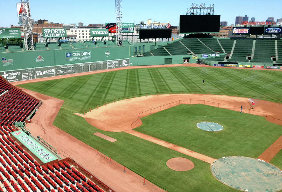 "The legendary Fenway Park was Eliot Linstrum's ""office during the 2012 major league baseball season. The New Milford High graduate worked on the Fenway grounds crew. 2012  Courtesy of the Linstrum family Photo: Contributed Photo"