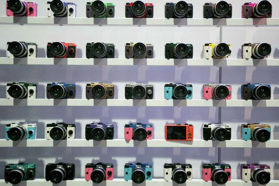 Ricoh Co.'s Pentax cameras sit on display during the 2013 Consumer Electronics Show in Las Vegas, Nevada, U.S., on Wednesday. Photo: Andrew Harrer, Bloomberg / © 2013 Bloomberg Finance LP