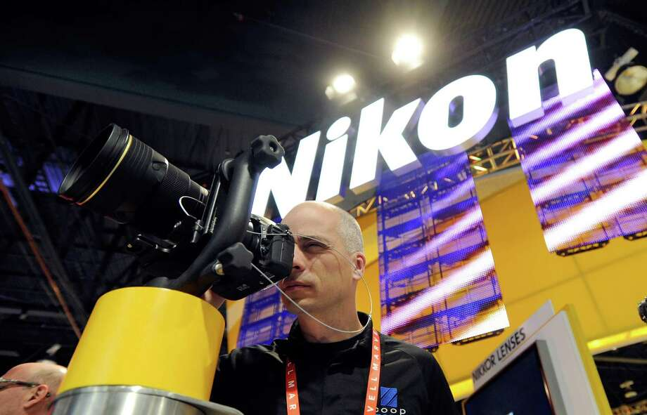 An attendee examines a Nikon camera Wednesday. Photo: David Becker, Getty Images / 2013 Getty Images