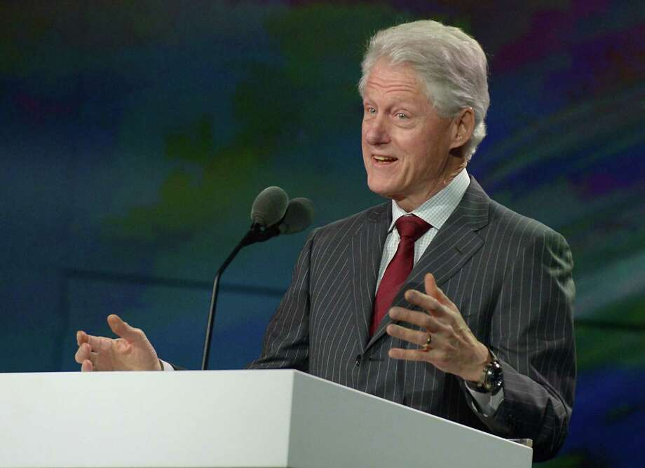 Former U.S. President Bill Clinton speaks during Samsung's press conference Wednesday. Photo: JOE KLAMAR, AFP/Getty Images / AFP