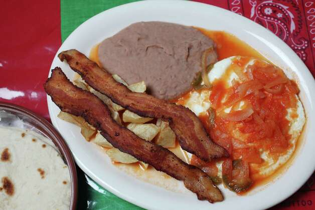 Huevos rancheros at Cowgirls Tuesday January 8 2012. Photo: Juanito M Garza, San Antonio Express-News / San Antonio Express-News