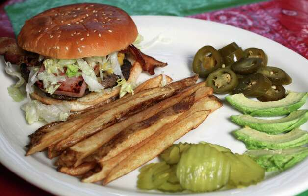 Mexican burger at Cowgirls Tuesday January 8 2012. Photo: Juanito M Garza, San Antonio Express-News / San Antonio Express-News