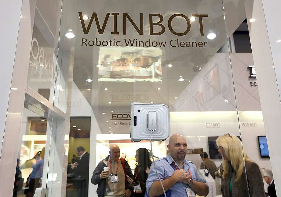The Winbot robotic window cleaner clings to the glass by suction, wets it and wipes it dry. Photo: Justin Sullivan, Getty Images