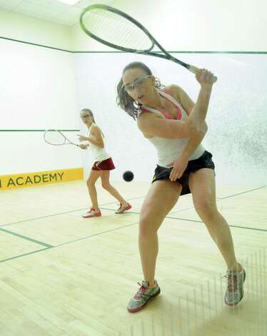 Lindsey Scott of Greenwich Academy hits against Eleanor Carroll of Taft during squash match at Greenwich Academy, Wednesday, Jan. 9, 2013. Photo: Bob Luckey / Greenwich Time