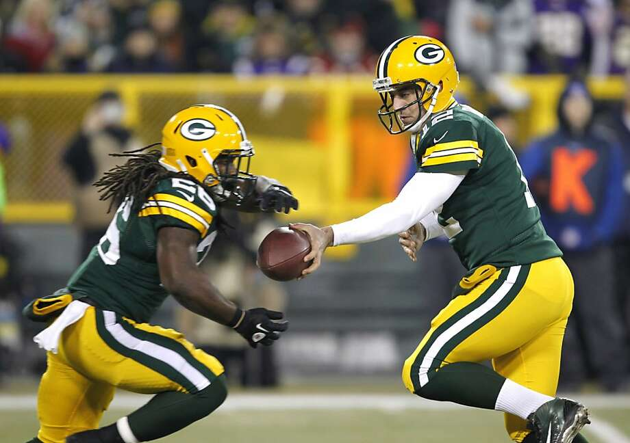 Quarterback Aaron Rodgers, handing off to DuJuan Harris in last week's playoff win, and the Packers have shown they can thrive as an underdog. Photo: Mike Roemer, Associated Press