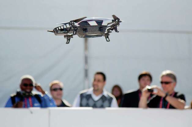 A Parrot AR Drone 2.0 is seen flying during a demonstration at the Consumer Electronics Show, Wednesday, Jan. 9, 2013, in Las Vegas. The drone has a built in camera and can be controlled with a smart phone. (AP Photo/Julie Jacobson) Photo: Julie Jacobson, Associated Press / AP