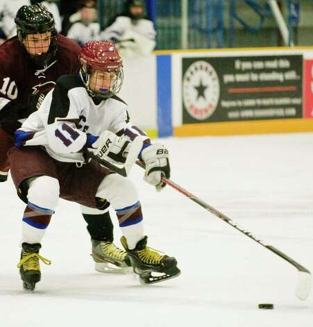 North Haven High School's Dylan VanBramer pesters BBD Icecats Will Lawrence in a game played at the Danbury Arena. Wednesday, Jan. 9, 2013 Photo: Scott Mullin / The News-Times Freelance