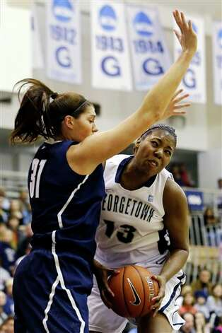 UConn center Stefanie Dolson (31) guards Georgetown center Sydney Wilson (13) during the first half of an NCAA college basketball game, Wednesday, Jan. 9, 2013, in Washington. (AP Photo/Alex Brandon)