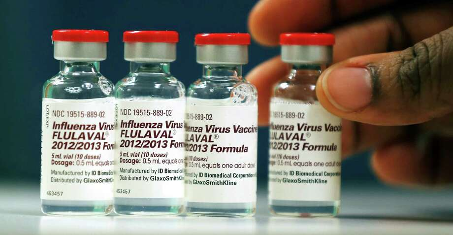 Vials of flu vaccine are displayed at the Whittier Street Health Center in Boston, Mass., Wednesday, Jan. 9, 2013. Photo: Charles Krupa, Associated Press / AP
