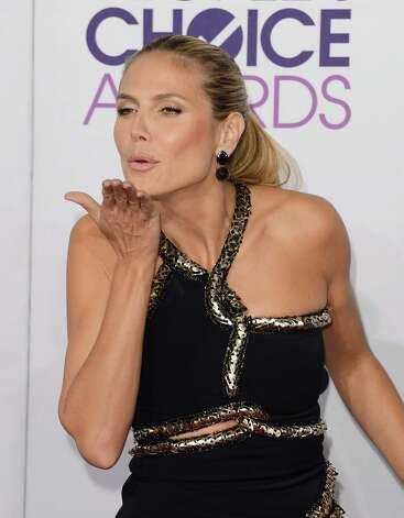 Heidi Klum blows a kiss to a lucky invisible man.  Photo: Jason Merritt, Getty Images / 2013 Getty Images