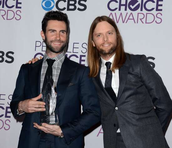 "Maroon 5 show off the award for ""Best Band."""