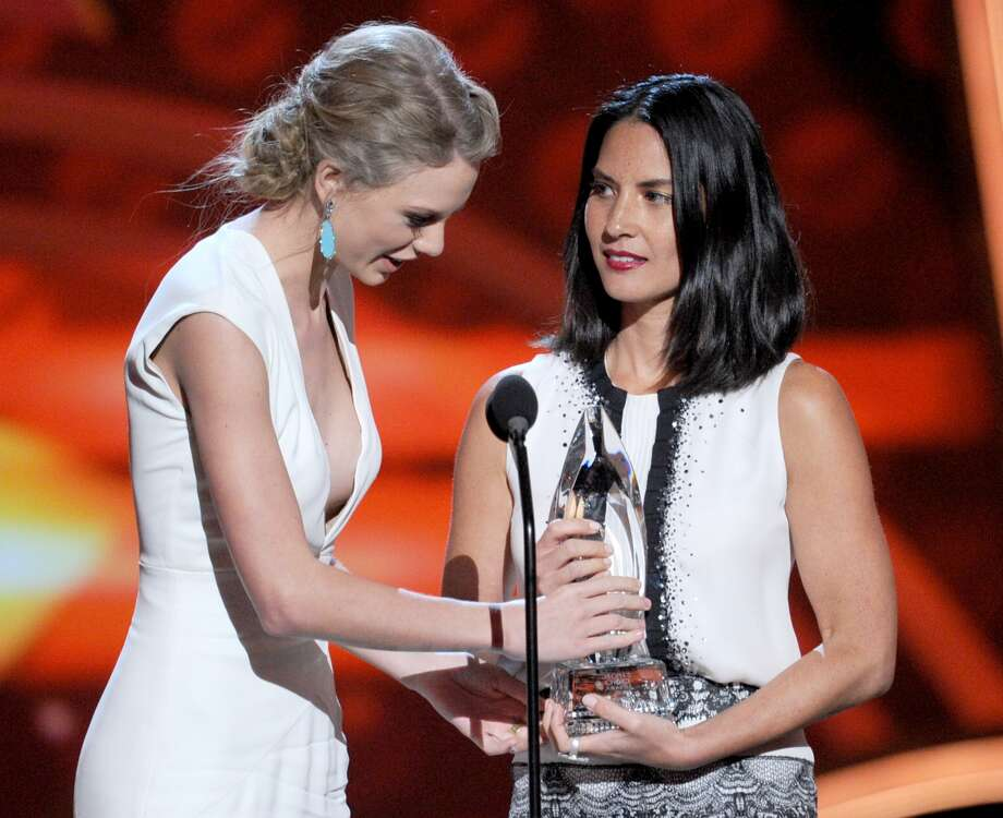 "Olivia Munn joked Taylor Swift's ""We Are Never Ever Getting Back Together"" was about her. Swift collected the award for Favorite Country Artist."