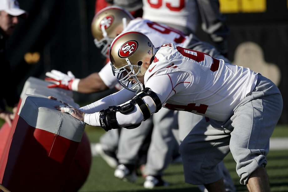 Niners defensive tackle Justin Smith wears a brace on his injured left arm as he works out in Santa Clara. Photo: Marcio Jose Sanchez, Associated Press