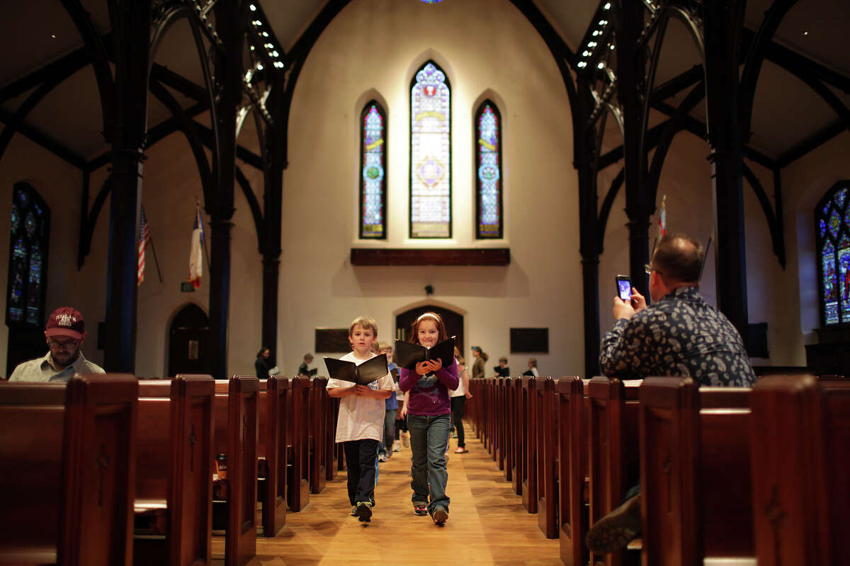 Scott Allison, left, and Christina Fisher lead the children's choir during practice at St. Mark's Episcopal Church, Wednesday, Jan. 9, 2013. The church under went a $15 million renovation and will hold it's formal celebration on February 3.