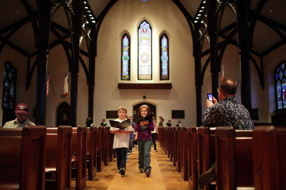 Scott Allison, left, and Christina Fisher lead the children's choir during practice at St. Mark's Episcopal Church on Wednesday.  The church underwent a $15 million renovation and will hold its formal celebration on Feb. 3. Photo: Jerry Lara, San Antonio Express-News / © 2013 San Antonio Express-News