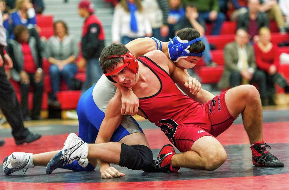 Fairfield Ludlowe high school's Joe Sokolski (blue/gray) on his way to defeating Fairfield Warde high school's Connor Price (red) in the a 171lb division match held at Warde high school Fairfield, CT on Wednesday January 9th, 2013. Photo: Mark Conrad / Connecticut Post Freelance