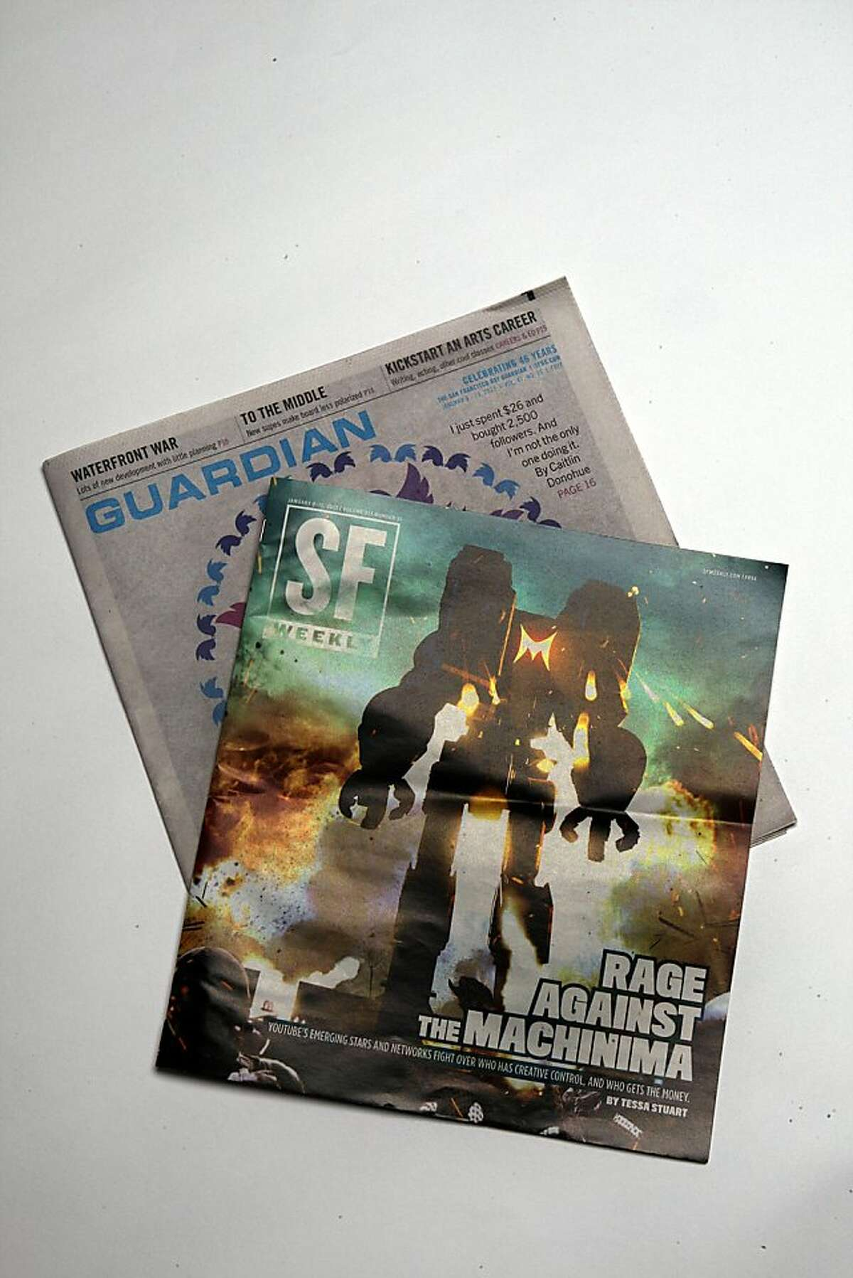 Recent issues of the Guardian and the SF Weekly.
