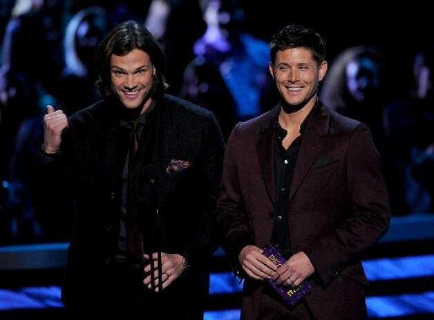 Actors Jared Padalecki (left) and Jensen Ackles talk sci-fi on stage.
