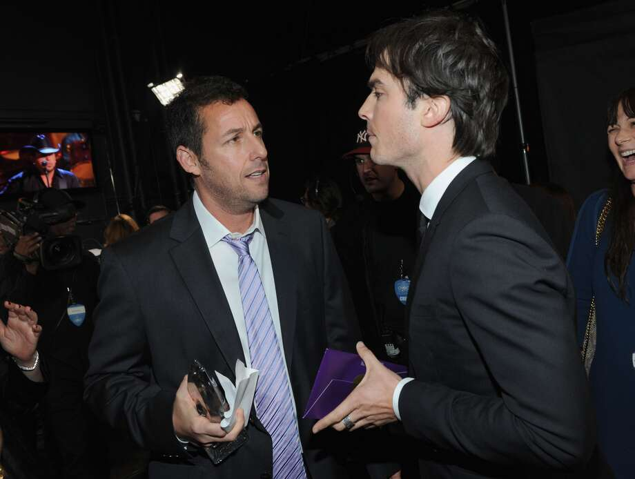 Actors Adam Sandler and Ian Somerhaldershare a moment backstage.