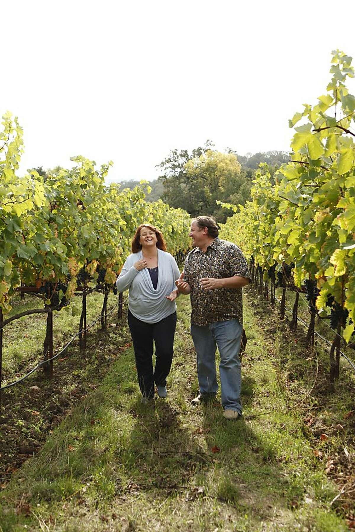 Nancy & John Lasseter walking in their Justi Creek Vineyards