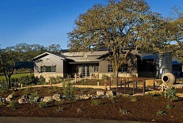 Lasseter Family Winery contemporary farmhouse style building, ringed by gardens and a small creek. Photo: George Rose