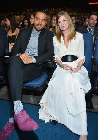 Actors Jesse Williams (left) and Ellen Pompeo relax in their seats.