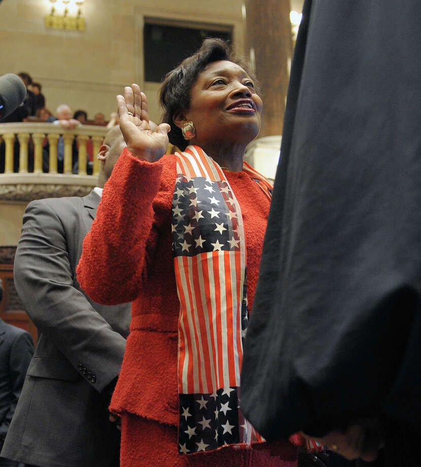 Senator Andrea Stewart-Cousins takes her oath on the floor of the Senate chambers on Wednesday, Jan. 9, 2013 in Albany, NY.  Senator Cousins was also elected the Democrat Conference Leader, the first woman leader in the Senate's history.  (Paul Buckowski / Times Union) Photo: Paul Buckowski  / 00020691A