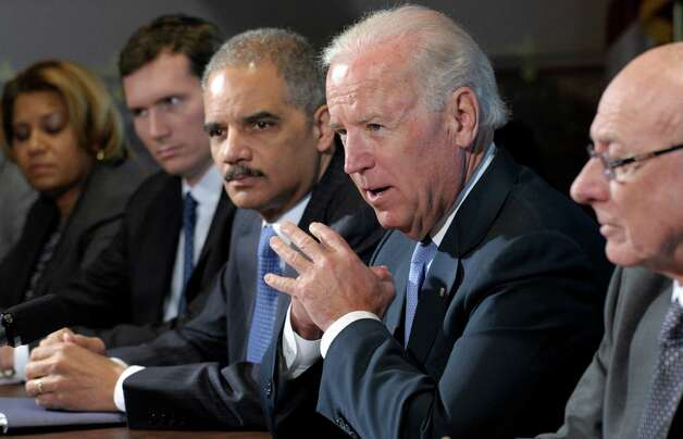 Vice President Joe Biden, with Attorney General Eric Holder at left, speaks during a meeting with victim's groups and gun safety organizations in the Eisenhower Executive Office Building on the White House complex in Washington, Wednesday, Jan. 9, 2013. Biden is holding a series of meetings this week as part of the effort he is leading to develop policy proposals in response to the Newtown, Conn., school shooting (AP Photo/Susan Walsh) Photo: Susan Walsh