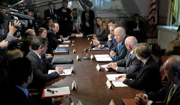 Vice President Joe Biden, fourth from right, with Attorney General Eric Holder at his left, speaks during a meeting with victim's groups and gun safety organizations in the Eisenhower Executive Office Building on the White House complex in Washington, Wednesday, Jan. 9, 2013. Biden is holding a series of meetings this week as part of the effort he is leading to develop policy proposals in response to the Newtown, Conn., school shooting (AP Photo/Susan Walsh) Photo: Susan Walsh