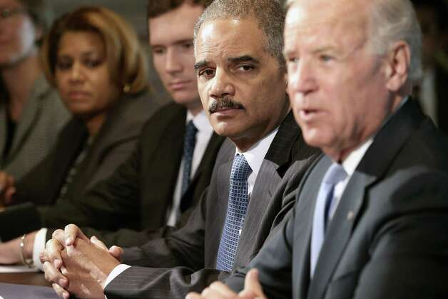 WASHINGTON, DC - JANUARY 09:  U.S. Attorney General Eric Holder (2nd R) listens as Vice President Joe Biden (R) makes brief remarks to the press at the beginning of a meeting with  and gun violence survivors and victims and gun safety advocacy groups in the Eisenhower Executive Office Building January 9, 2013 in Washington, DC. President Barack Obama appointed Biden to oversee a task force on gun violence.  (Photo by Chip Somodevilla/Getty Images) Photo: Chip Somodevilla