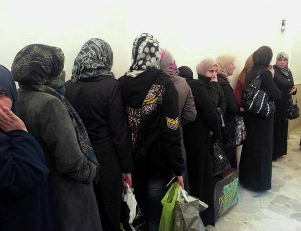 In this photo provided by the Turkish Islamic aid group IHH, freed Syrian prisoners released by the Syrian government are seen in Damascus, Syria, Wednesday, Jan. 9, 2013. Syrian rebels freed 48 Iranians held captive since August, Iranian state TV reported Wednesday, part of what appeared to be the first major prisoner swap of the civil war. The deal, reportedly coordinated by the IHH, will also involve the release of more than 2,000 Syrians held by Bashar Assad's regime, Turkey's state-run agency Anadolu Agency reported. (AP Photo/IHH)