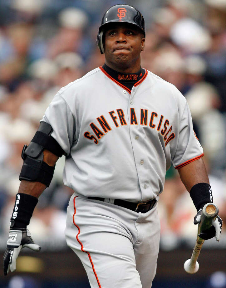 FILE - In this April 3, 2006, file photo, San Francisco Giants' Barry Bonds grimaces as he walks back to the dugout after flying out during the sixth inning of a baseball game against the San Diego Padres in San Diego. With the cloud of steroids shrouding many candidacies, baseball writers may fail for the only the second time in more than four decades to elect anyone to the Hall. (AP Photo/Denis Poroy, File) Photo: DENIS POROY