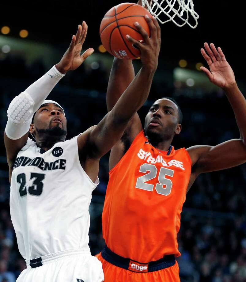 Providence's LaDontae Henton (23) shoots against Syracuse's Rakeem Christmas (25) in the first half of an NCAA college basketball game in Providence, R.I., Wednesday, Jan. 9, 2013. (AP Photo/Michael Dwyer) Photo: Michael Dwyer