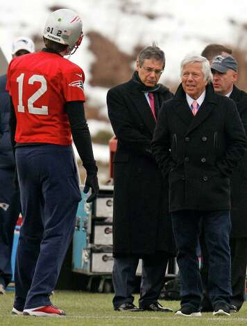 New England Patriots quarterback Tom Brady (12) talks with team owner Robert Kraft, right, during practice at the team's NFL football facility in Foxborough, Mass., Wednesday, Jan. 9, 2013. The Patriots host the Houston Texans in an AFC divisional playoff game on Sunday. (AP Photo/Stephan Savoia) Photo: Stephan Savoia