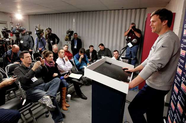 New England Patriots quarterback Tom Brady answers a reporter's question during a media availability at the NFL football team's facility in Foxborough, Mass., Wednesday, Jan. 9, 2013. (AP Photo/Stephan Savoia) Photo: Stephan Savoia