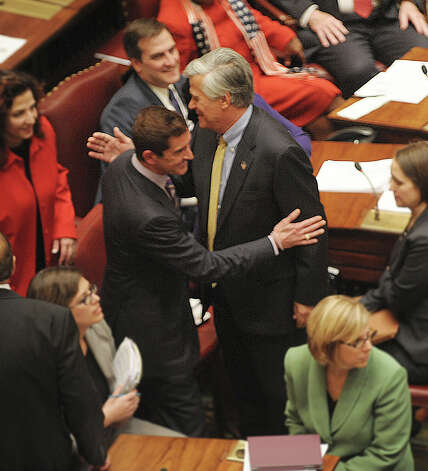 Newly elected co-leaders of the Senate, Senator Jeffrey Klein, left, and Senator Dean Skelos give each other a pat on the shoulder as they pass on the floor of the Senate on Wednesday, Jan. 9, 2013 in Albany, NY.   (Paul Buckowski / Times Union) Photo: Paul Buckowski  / 00020691A