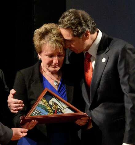 Governor Andrew Cuomo consoles deceased firefighter Thomas Kaczowka's mother Janina Kaczowka before his State of the State address Jan. 9. 2013 in Albany, N.Y.  Thomas Kaczowka was one of the firefighters shot to death while responding to a fire call in Webster, N.Y.   (Skip Dickstein/Times Union) Photo: SKIP DICKSTEIN / 00020691B