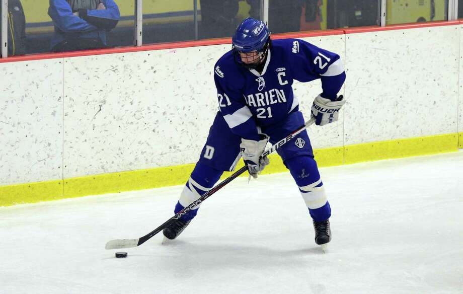 Darien's Brendan Hathaway (21) controls the puck during the boys hockey game against Westhill High School at Terry Connors Rink in Stamford on Wednesday, Jan. 9, 2013. Photo: Amy Mortensen / Connecticut Post Freelance