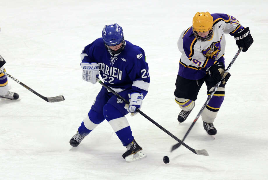 Darien's Jack Pardue (22) and Westhill's Kevin Rotkewicz (19) battle for control of the puck during the boys hockey game at Terry Connors Rink in Stamford on Wednesday, Jan. 9, 2013. Photo: Amy Mortensen / Connecticut Post Freelance