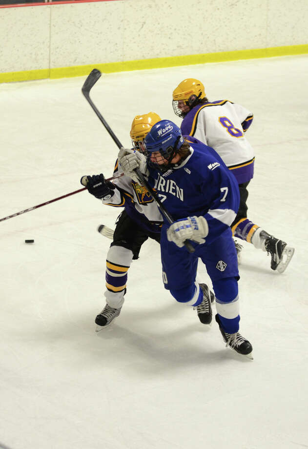 Darien's Jack Knowlton (7) and Westhill's Matthew Abt (10) go after the puck during the boys hockey game at Terry Connors Rink in Stamford on Wednesday, Jan. 9, 2013. Photo: Amy Mortensen / Connecticut Post Freelance