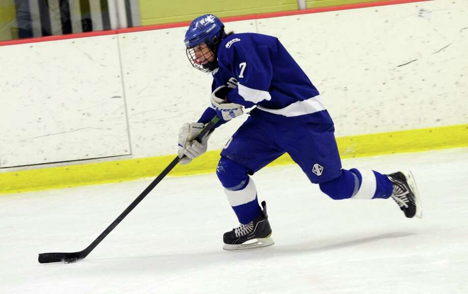Darien's Jack Knowlton (7) controls the puck during the boys hockey game against Westhill High School at Terry Connors Rink in Stamford on Wednesday, Jan. 9, 2013. Photo: Amy Mortensen / Connecticut Post Freelance