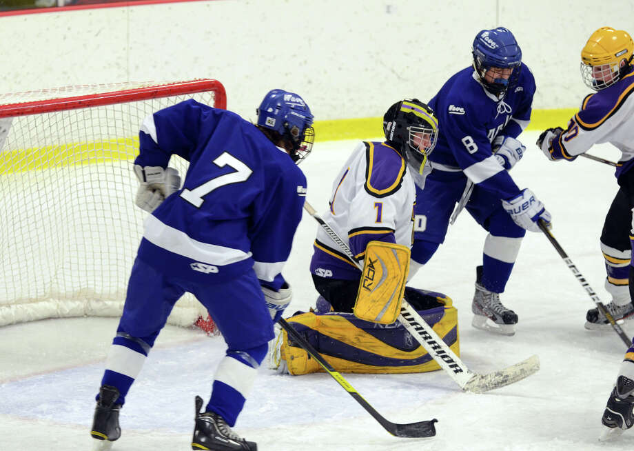 Westhill's Tyler Phillipson (1) defends the goal during the boys hockey game against Darien High School at Terry Connors Rink in Stamford on Wednesday, Jan. 9, 2013. Photo: Amy Mortensen / Connecticut Post Freelance